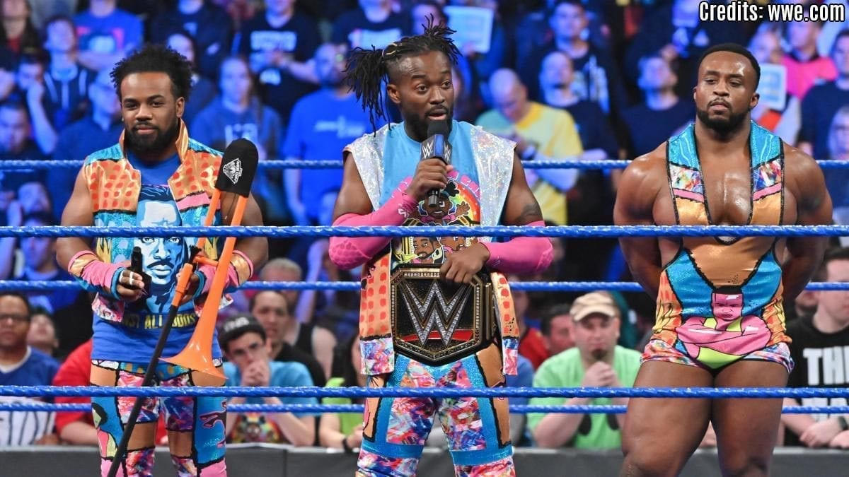 Kofi and New Day with WWE championship