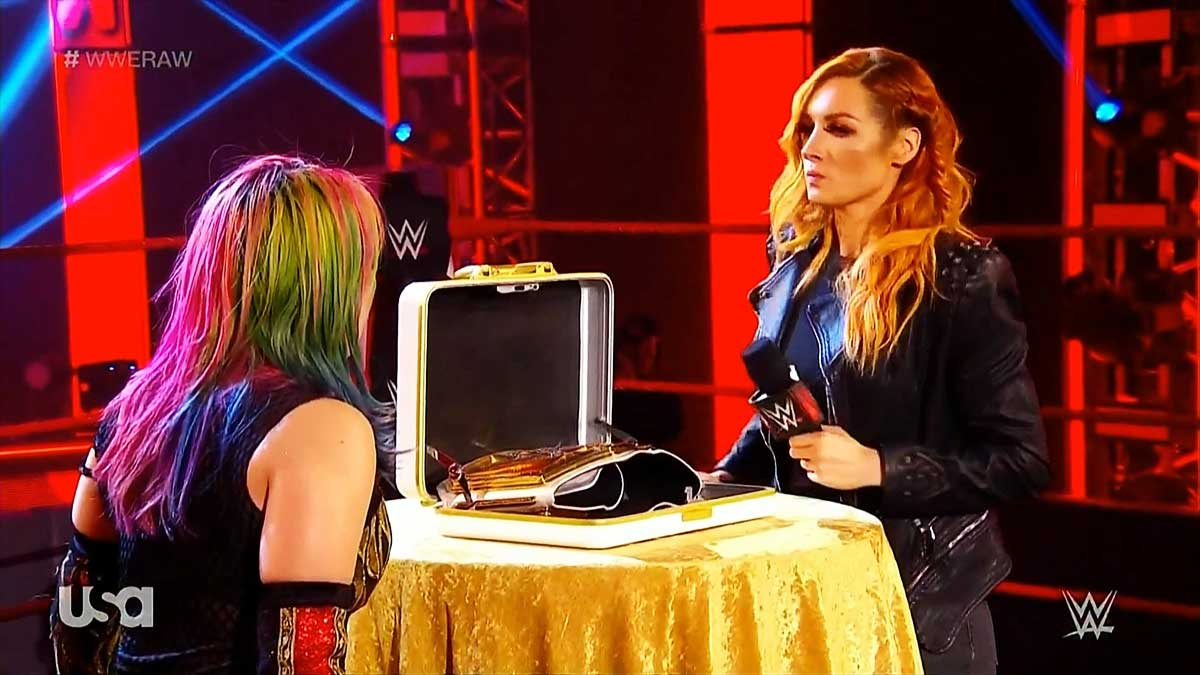Becky Lynch hands title to Asuka